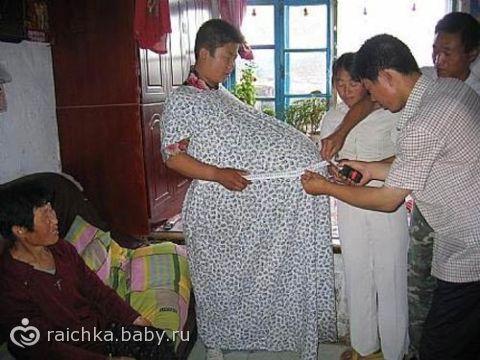 самый большой живот у беременной фото в мире